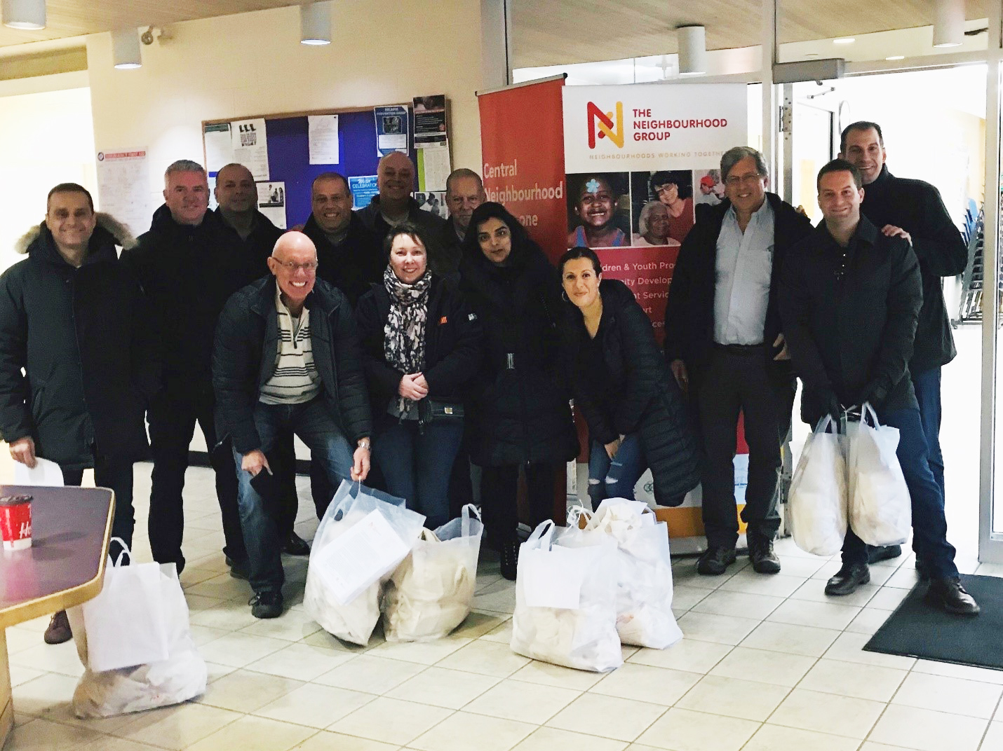 Canadian Leadership team volunteering with the organization The Neighbourhood Group with their annual December Friendly Holiday Gift Giving Program.